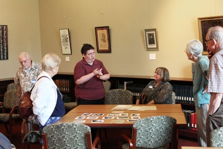 Intern Annie Monn explains some of the topics discussed in the Stewart W. Herman Jr. papers.